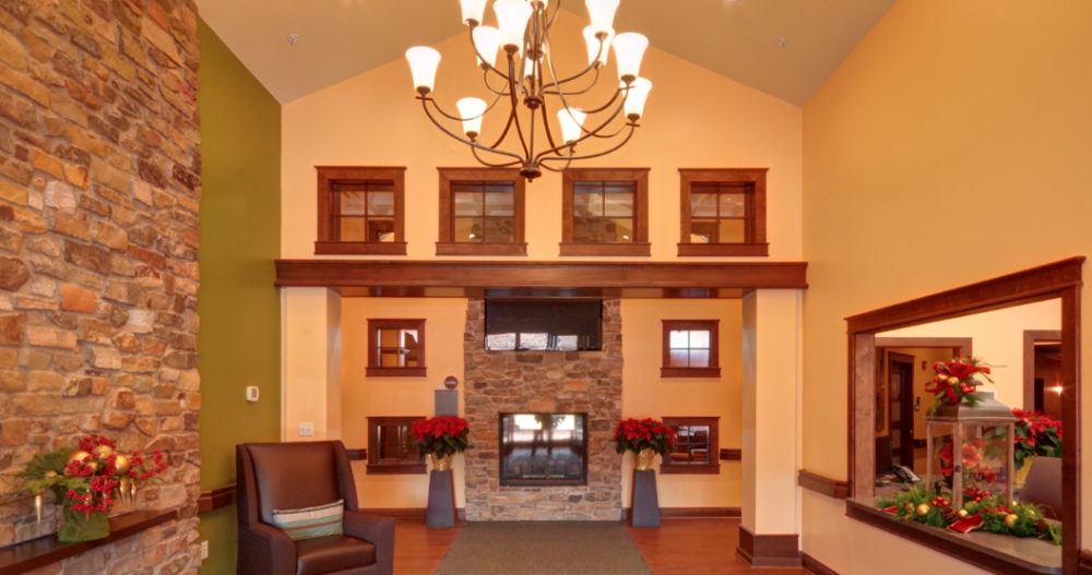 Senior living interior design example — welcoming hotel style sitting room at Stillwater Senior Senior Living in Edwardsville, IL.