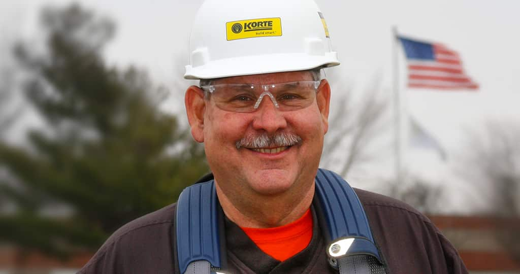 Kevin Moorehead smiling and wearing a hard hat.
